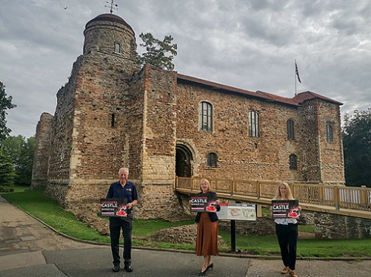 Three people standing outside Colchester Castle